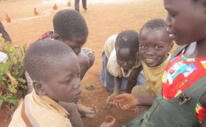 Spreading Games in Rural Uganda to Solve Problems