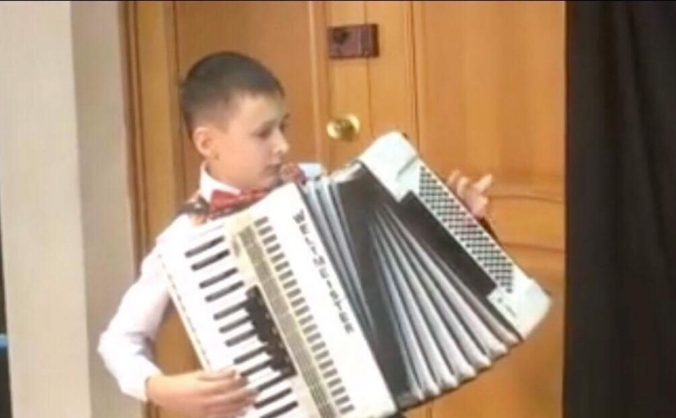 to buy a blind Russian boy , his own  accordion
