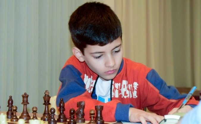 Young child participating in int. chess tournament