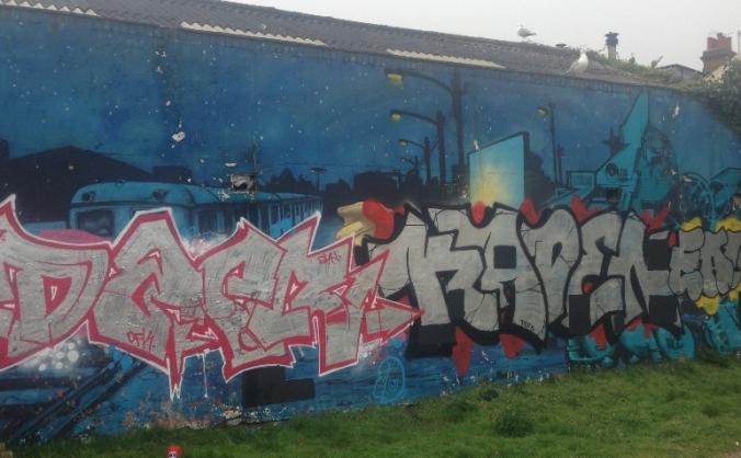 Repainting the Mural Wall in Stoneham Park, Hove