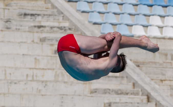 Help a young springboard diver achieve his dream