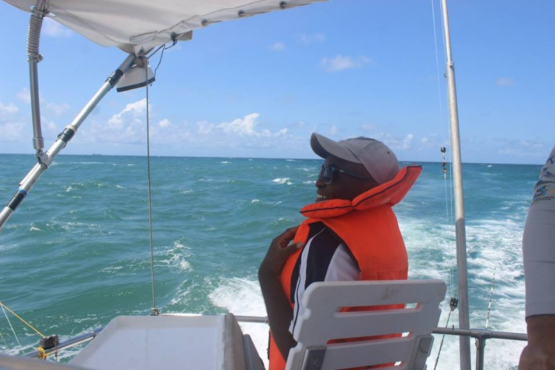 Kahindi on board Hemingways vessel conducting whale survey