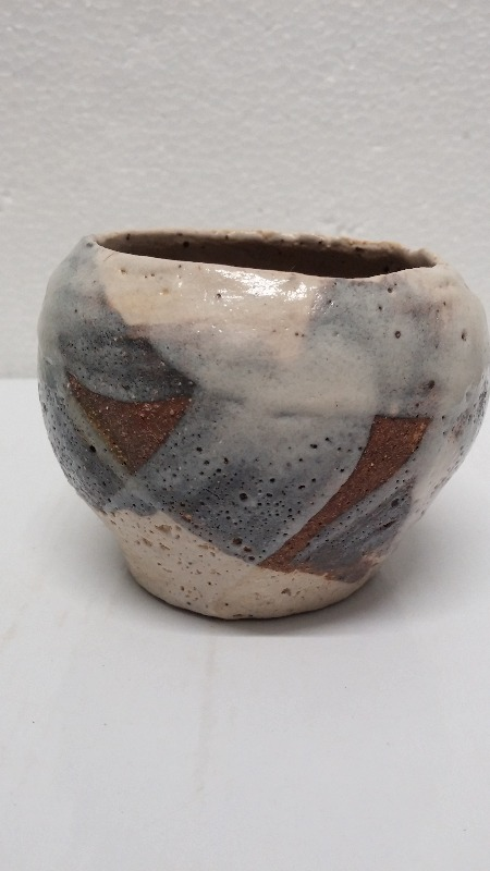 SAKE/BRANDY/COGNAC CUP.  stoneware,  carved by hand,  three shino glaze