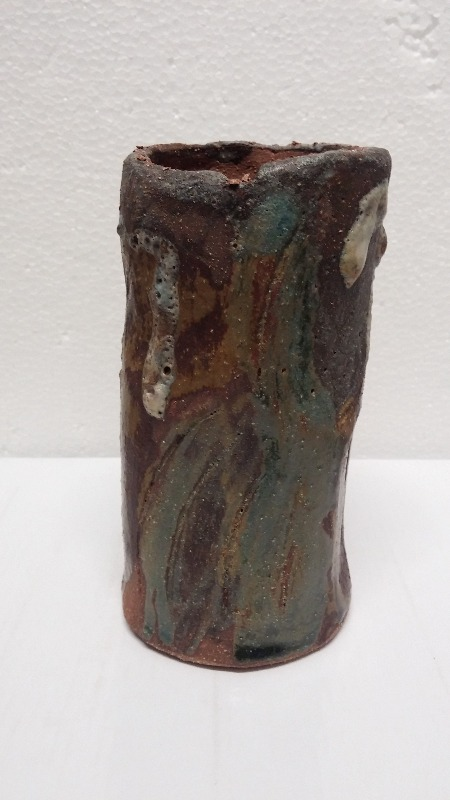 VASE. Stoneware. Carved by hand. Shino + red slip (with green, black and blue glazes)