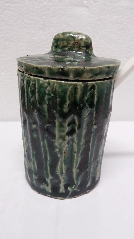 SUGAR POT.  stoneware,  carved by hand,  matte green and black glaze