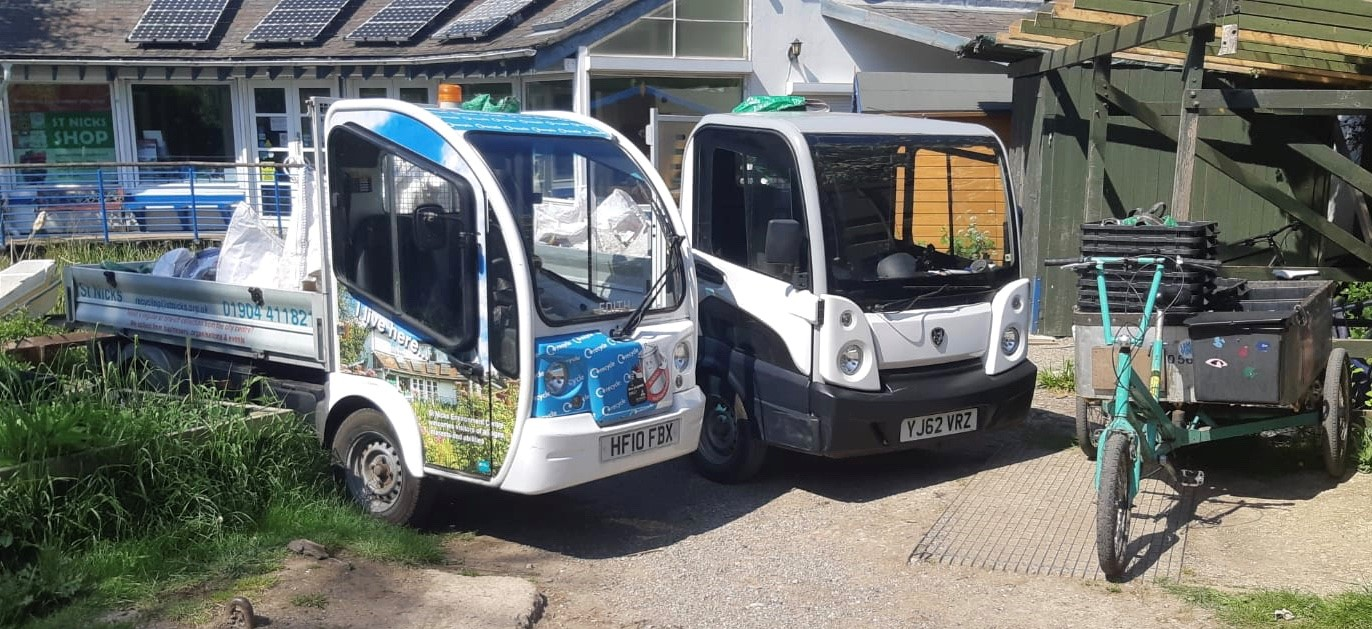An image of our two electric vehicles, Doris and Edith and one of our load bearing tricycles.