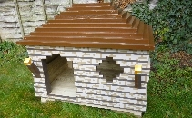 Wooden doghouses and art