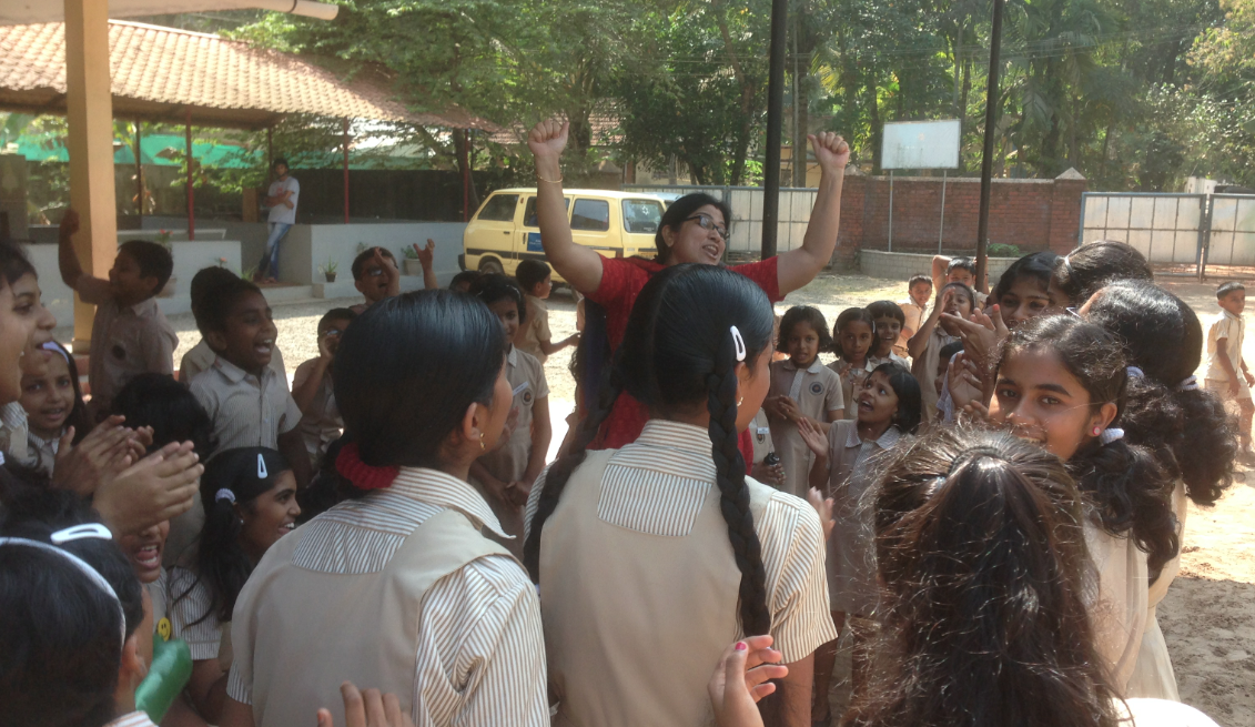 Usha leading the cheering