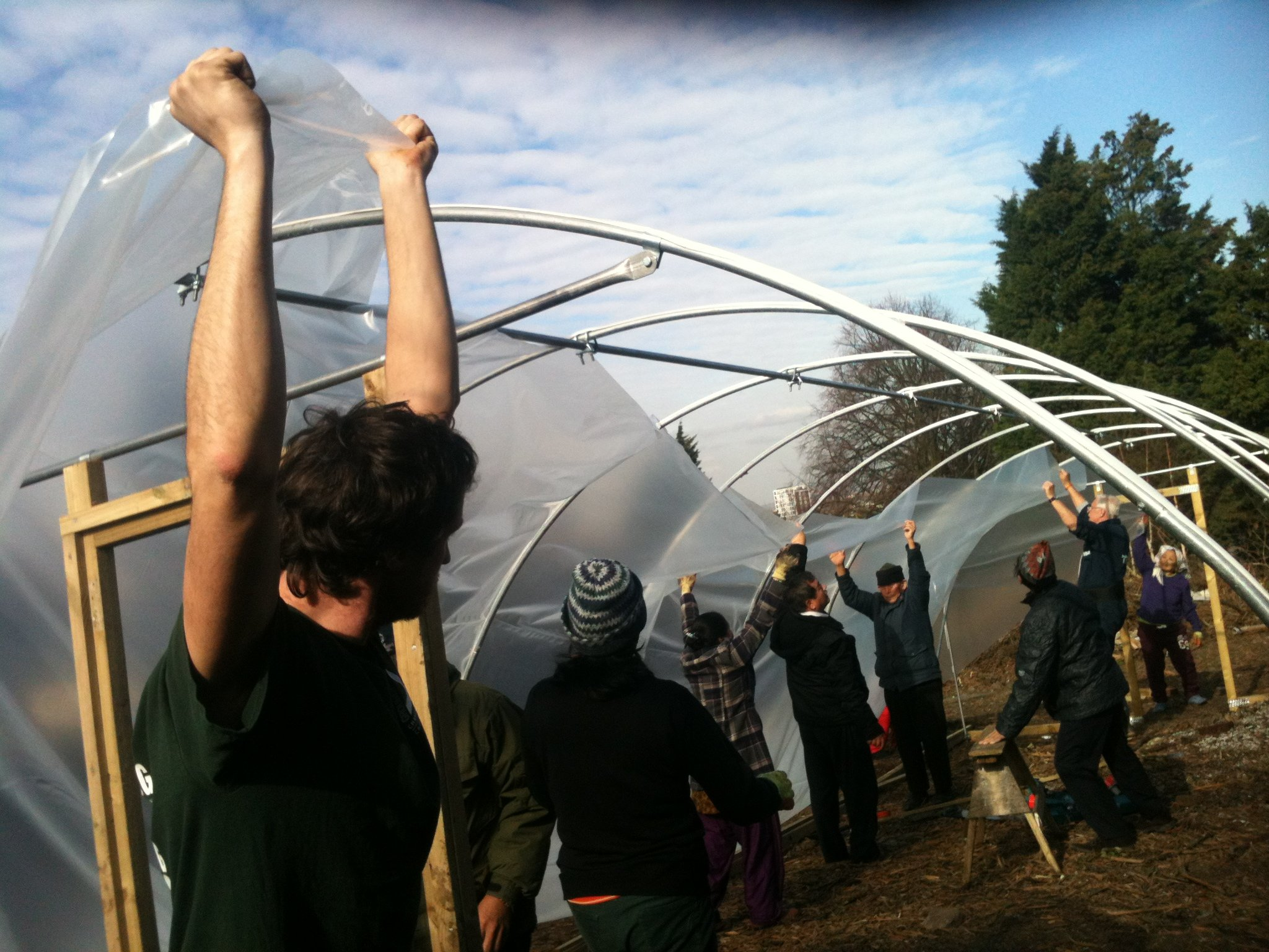 Putting up a polytunnel on one of our previous projects