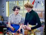 Two women in '50s kitchen