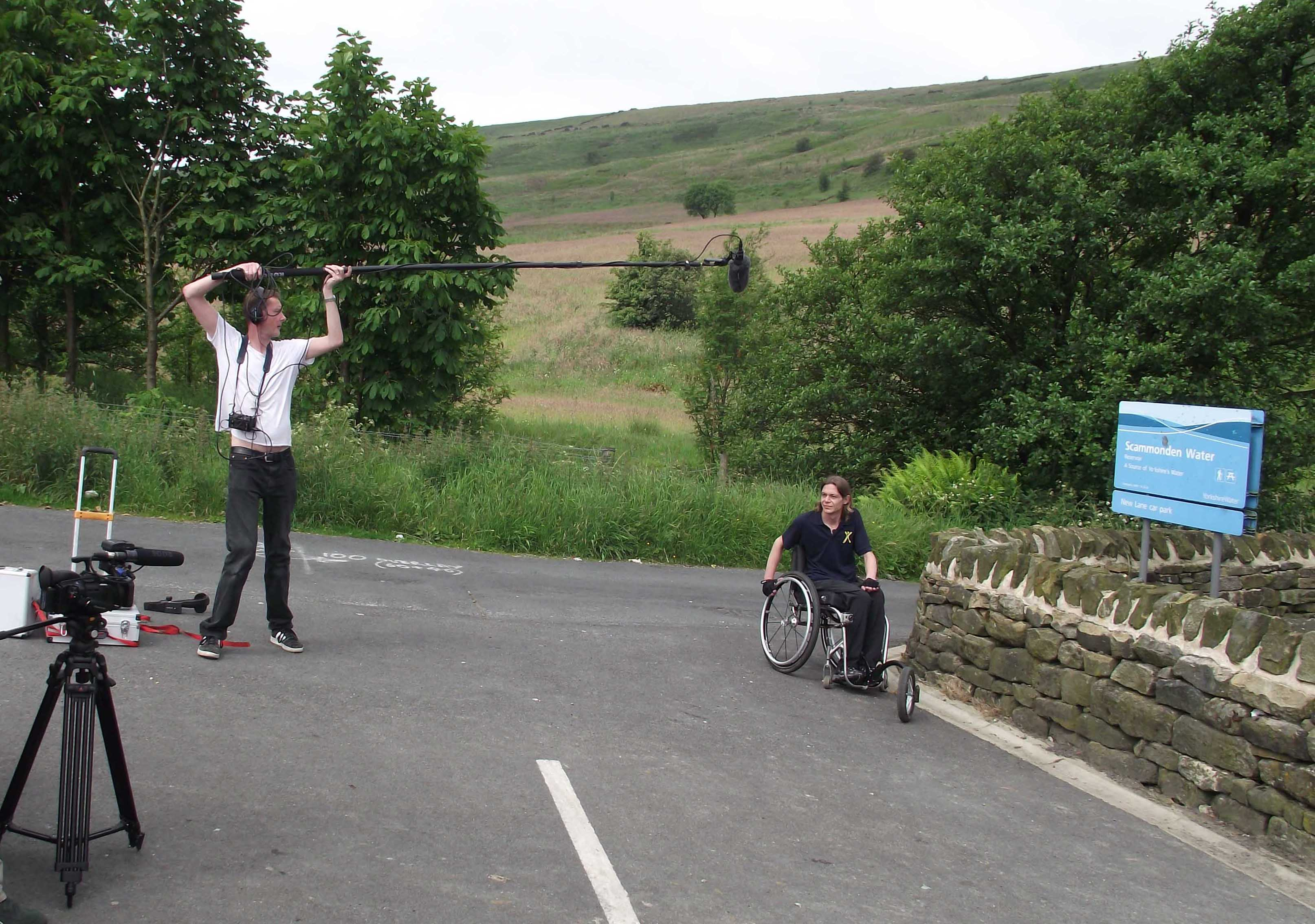 Craig Grimes and a volunteer filming at Scammonden Water, Huddersfield