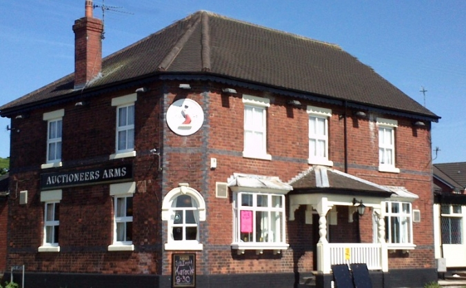 Help save the auctioneers arms image