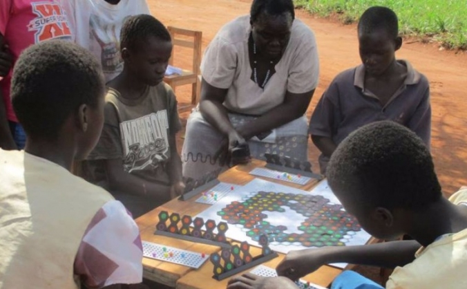The ugandan village boardgame convention image