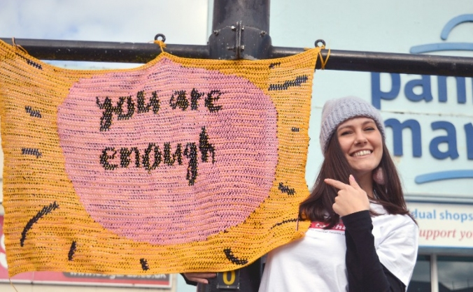 We are enough; the creative yarn bomb of love image