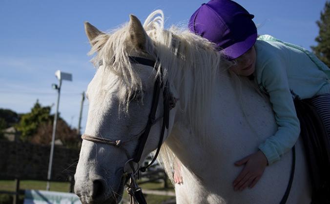 Empowering children through riding image