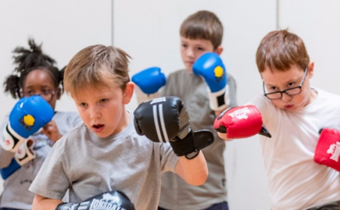 Action youth boxing intervention image